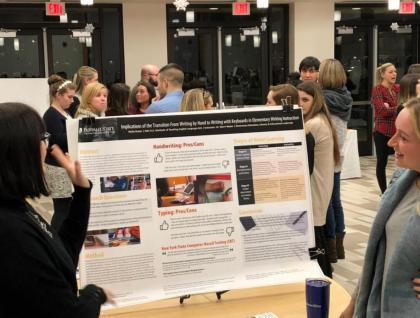 Molly Rutter with poster, Graduate Poster Night 2018
