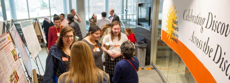 students conversing at student research and creativity conference 2019
