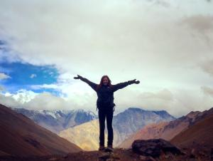 student standing by the Andes Mountains